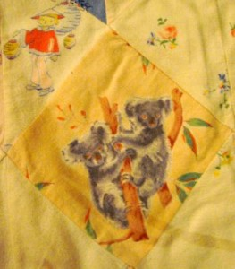 Koalas, Indonesian children with blonde hair, and the word 'Pinkie' in the baby quilt that Kitty made for Arnold.
