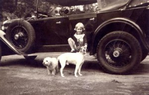 Henriette, aged 3 with her pet dogs.