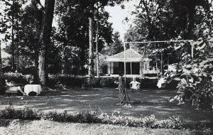 Anton on the swing with his favourite 'baboe' Anna standing nearby. Photo taken in Buitenzorg (now Bogor) 1940.